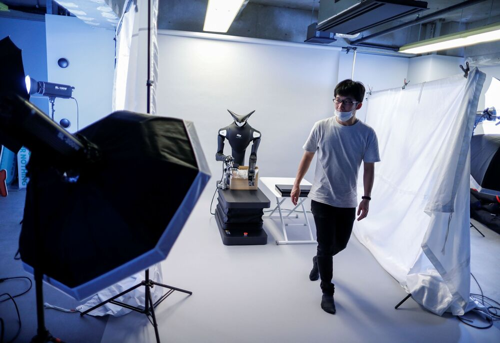 A staff member of the Telexistence company during preparations ahead of unveiling a shelf-stacking avatar robot in Tokyo, Japan on 3 July, 2020