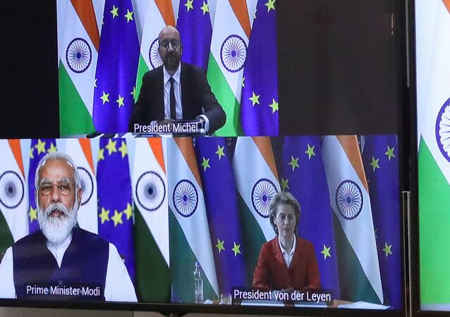 European Council President Charles Michel, Ursula von der Leyen and Indian Prime Minister Narendra Modi are seen on the monitor as they take part in a virtual summit, in Brussels, Belgium, July 15, 2020. REUTERS/Yves Herman/Pool
