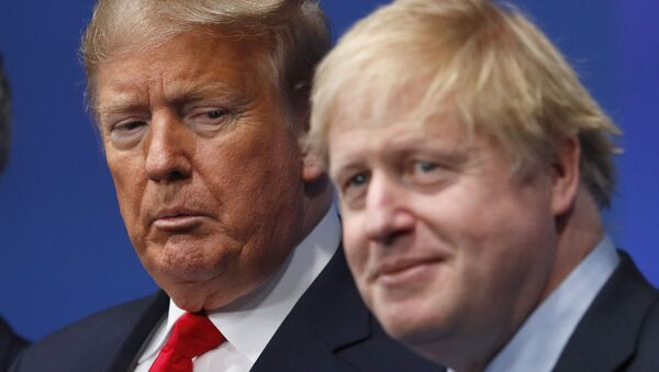 British Prime Minister Boris Johnson, right, and U.S. President Donald Trump pose during a group photo during a NATO leaders meeting at The Grove hotel and resort in Watford, Hertfordshire, England, Wednesday, Dec. 4, 2019.  - Sputnik International
