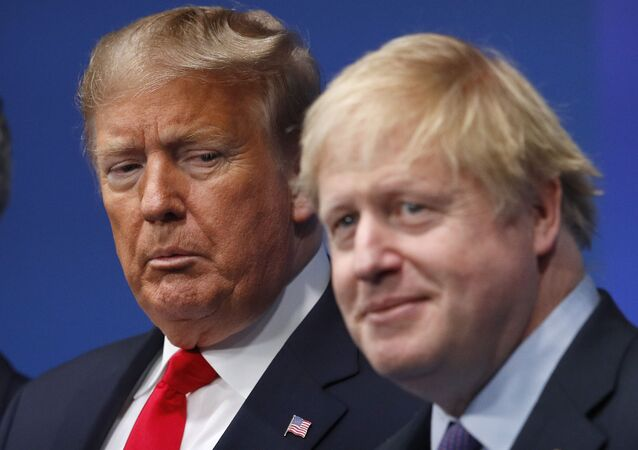 British Prime Minister Boris Johnson, right, and U.S. President Donald Trump pose during a group photo during a NATO leaders meeting at The Grove hotel and resort in Watford, Hertfordshire, England, Wednesday, Dec. 4, 2019.