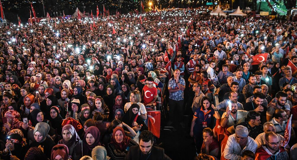 People lit lights of their mobile phones as they read the names of people killed during the July 15, 2016 coup attempt, while standing near the July 15 Martyrs Bridge (Bosphorus Bridge) in Istanbul on July 15, 2018.
