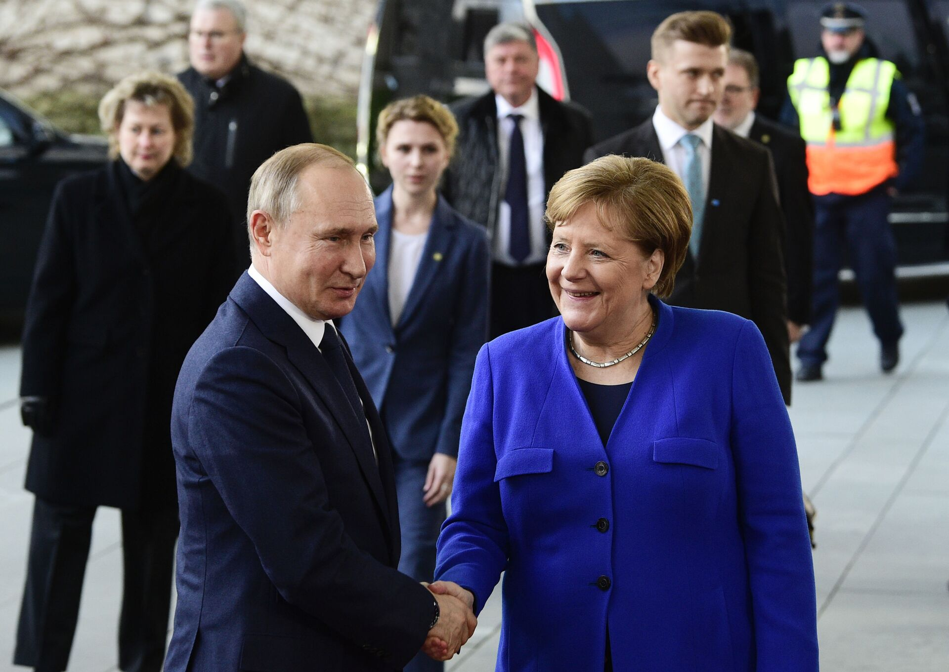 German Chancellor Angela Merkel, right, shakes hands with Russian President Vladimir Putin during arrivals for a conference on Libya at the chancellery in Berlin, Germany, Sunday, Jan. 19, 2020 - Sputnik International, 1920, 07.09.2021