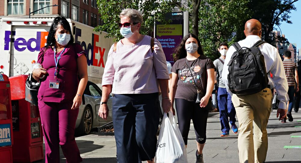 People walk while wearing protective masks as New York City moves into Phase 3 of re-opening following restrictions imposed to curb the coronavirus pandemic on July 14, 2020.