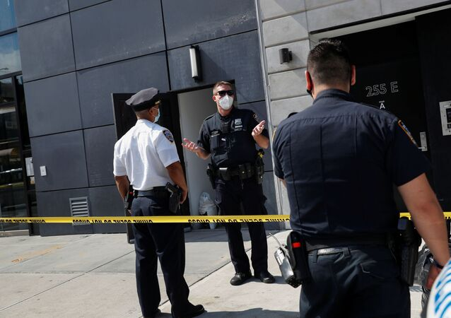 NYPD officers speak at crime scene at 265 Houston Street, where Fahim Saleh, Co-founder/CEO of Gokada, was found dead at the apartment building in New York City, New York, U.S., July 15, 2020.