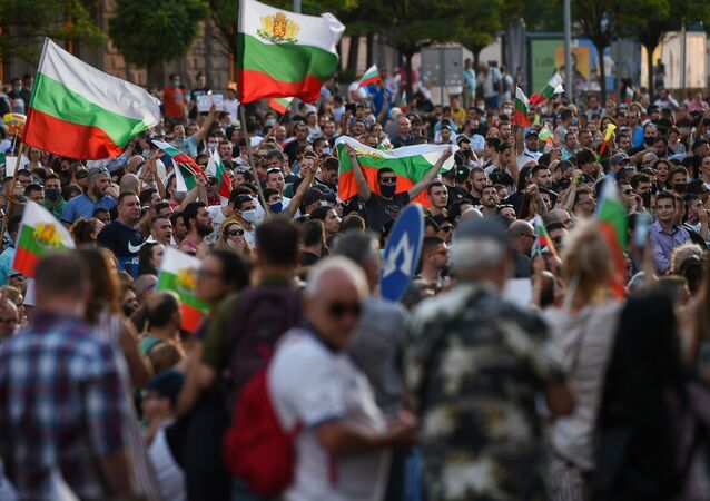 Protestors shout slogans and wave Bulgarian national flags during an anti-government protest in Sofia, on July 11, 2020.