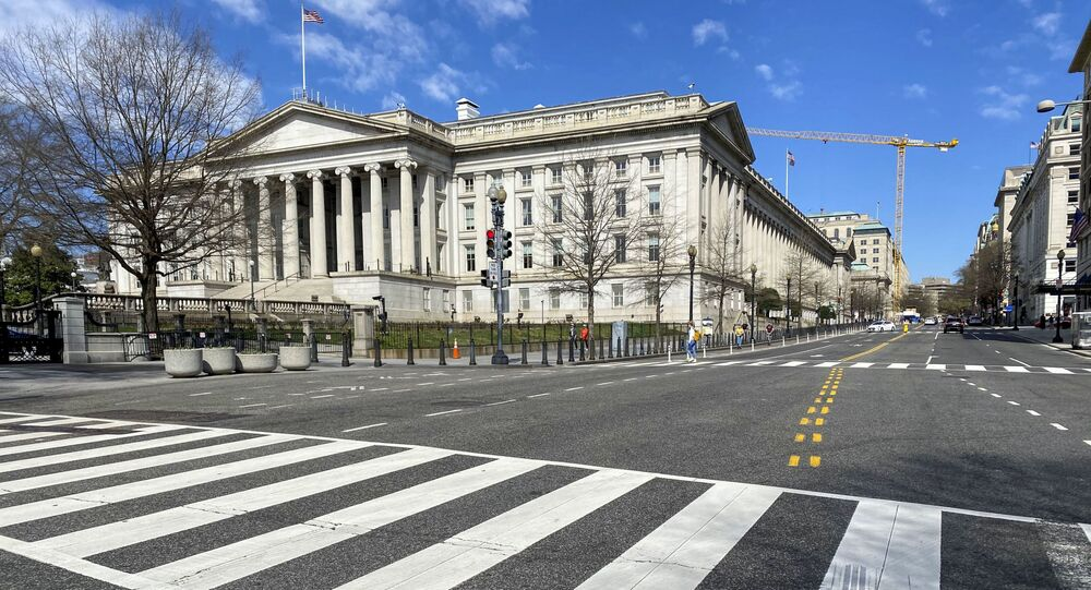 In this file photo taken on March 13, 2020 the US Treasury Department building is seen next to an almost empty 15th Street at noon in Washington DC.
