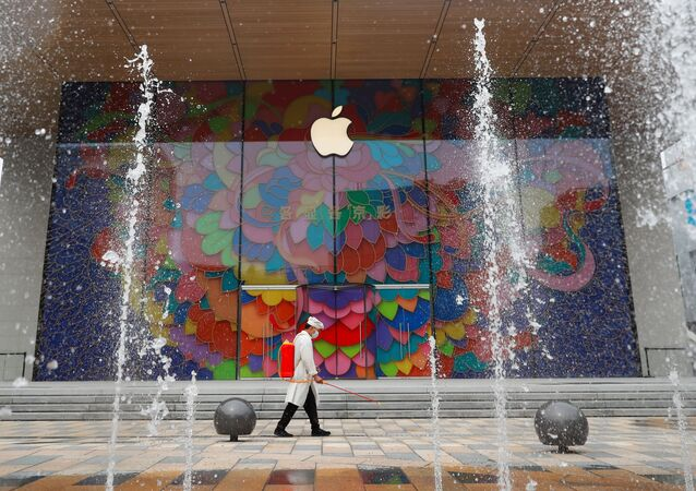 A worker sprays disinfectant outside the new Apple flagship store in Sanlitun after an outbreak of the coronavirus disease (COVID-19) in Beijing, China July 13, 2020
