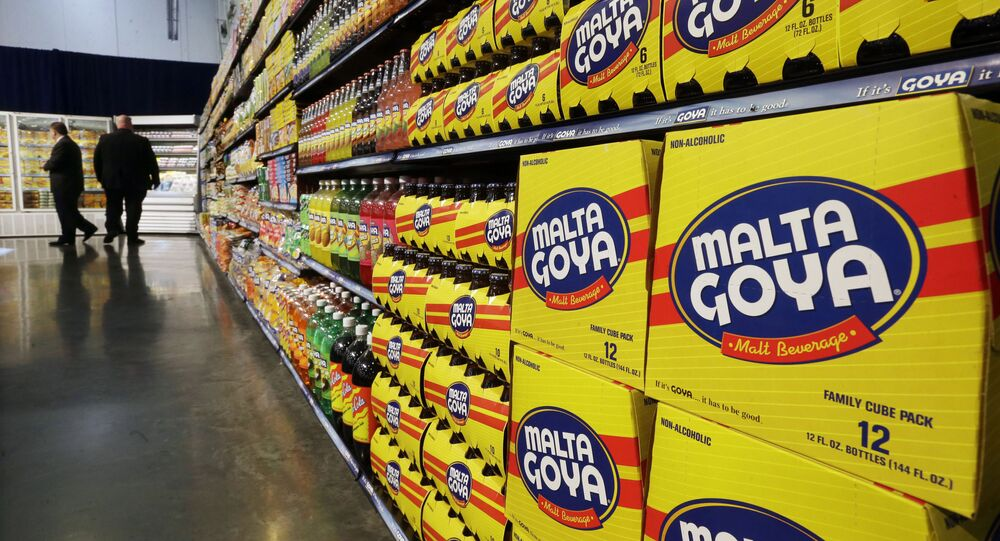 In this April 29, 2015, file photo, people walk past displays of Goya Foods products at the new corporate headquarters in Jersey City, N.J. Goya Foods is facing a a swift backlash after its CEO Robert Unanue praised President Donald Trump at White House event on Thursday, July 9, 2020