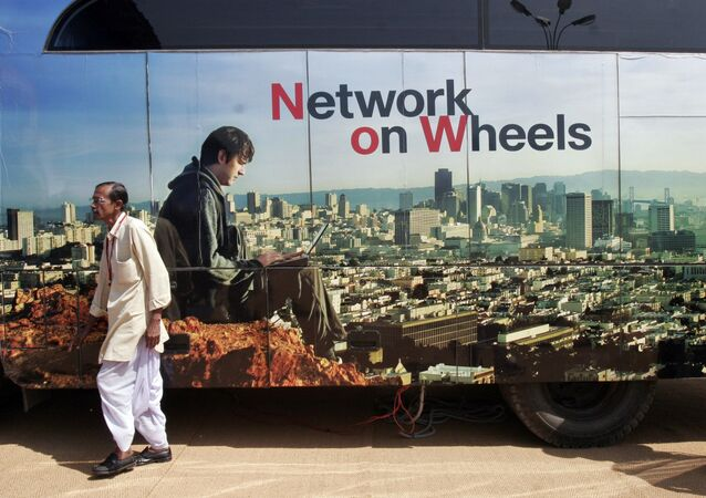A man walks past a billboard of an information technology (IT) company at BangaloreIT.biz in Bangalore, India, Thursday, Nov. 6, 2008