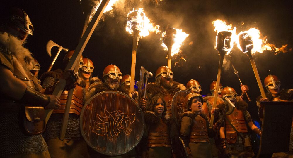 People dressed as Vikings get ready to lead a torchlight procession in Edinburgh, which marks the opening of Edinburgh's New Year celebrations, Saturday Dec. 30, 2017