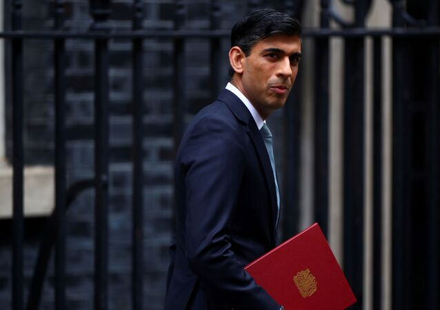 Britain's Chancellor of the Exchequer Rishi Sunak reacts as he leaves Downing Street, in London, Britain July 8, 2020.