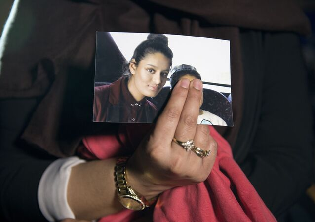 Renu, eldest sister of missing British girl Shamima Begum, holds a picture of her sister while being interviewed by the media in central London, on February 22, 2015