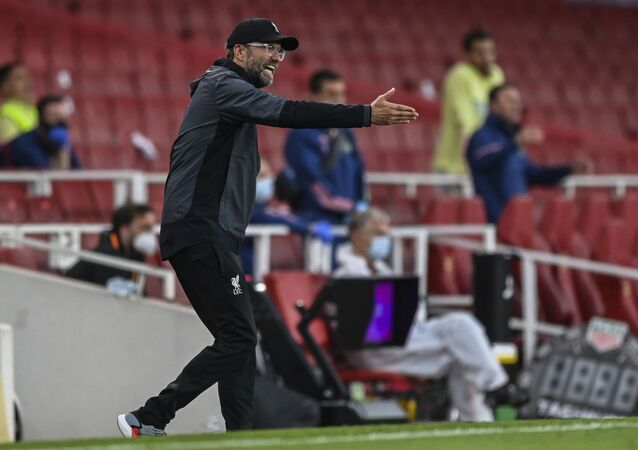 Liverpool's manager Jurgen Klopp gestures during the English Premier League soccer match between Arsenal and Liverpool at the Emirates Stadium in London, England, Wednesday, July 15, 2020.