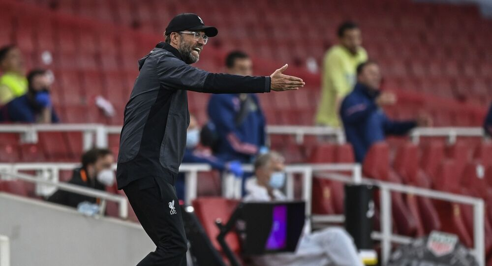 Liverpool's manager Jurgen Klopp gestures during the English Premier League soccer match between Arsenal and Liverpool at the Emirates Stadium in London, England, 15 July 2020.