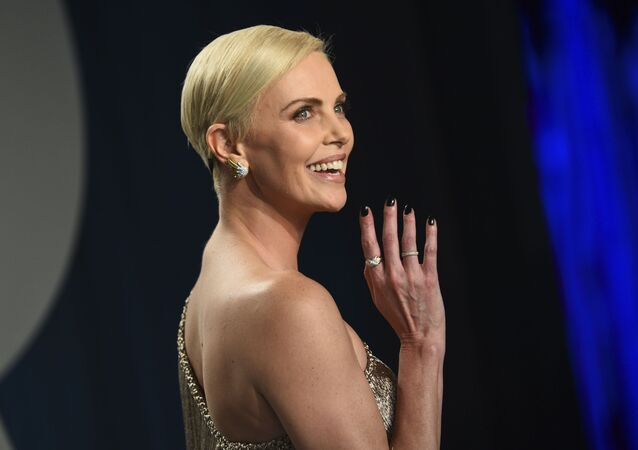 Charlize Theron arrives at the Vanity Fair Oscar Party on Sunday, Feb. 9, 2020, in Beverly Hills, Calif