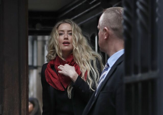 Actress Amber Heard, center, arrives at the High Court in London, Thursday, July 16, 2020