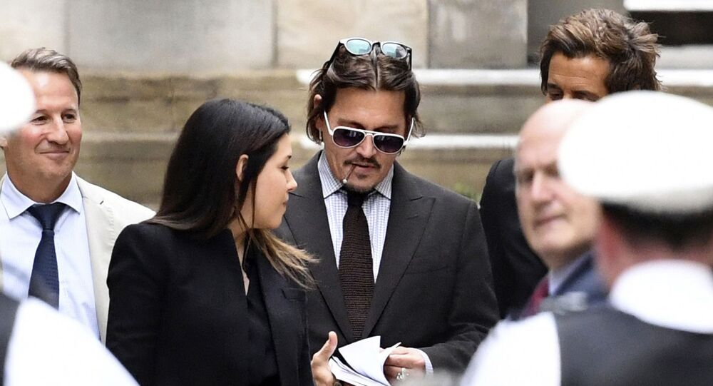 Actor Johnny Depp leaves the High Court in London, Wednesday July 15, 2020