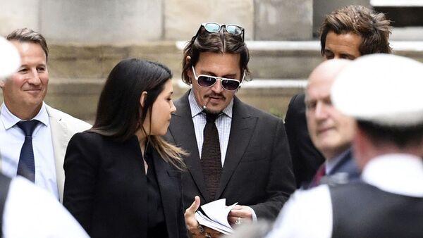 Actor Johnny Depp leaves the High Court in London, Wednesday July 15, 2020 - Sputnik International