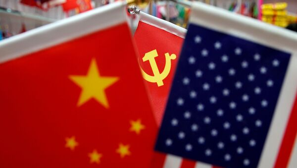 The flags of China, U.S. and the Chinese Communist Party are displayed in a flag stall at the Yiwu Wholesale Market in Yiwu, Zhejiang province, China, May 10, 2019. - Sputnik International