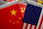The flags of China, U.S. and the Chinese Communist Party are displayed in a flag stall at the Yiwu Wholesale Market in Yiwu, Zhejiang province, China, May 10, 2019.
