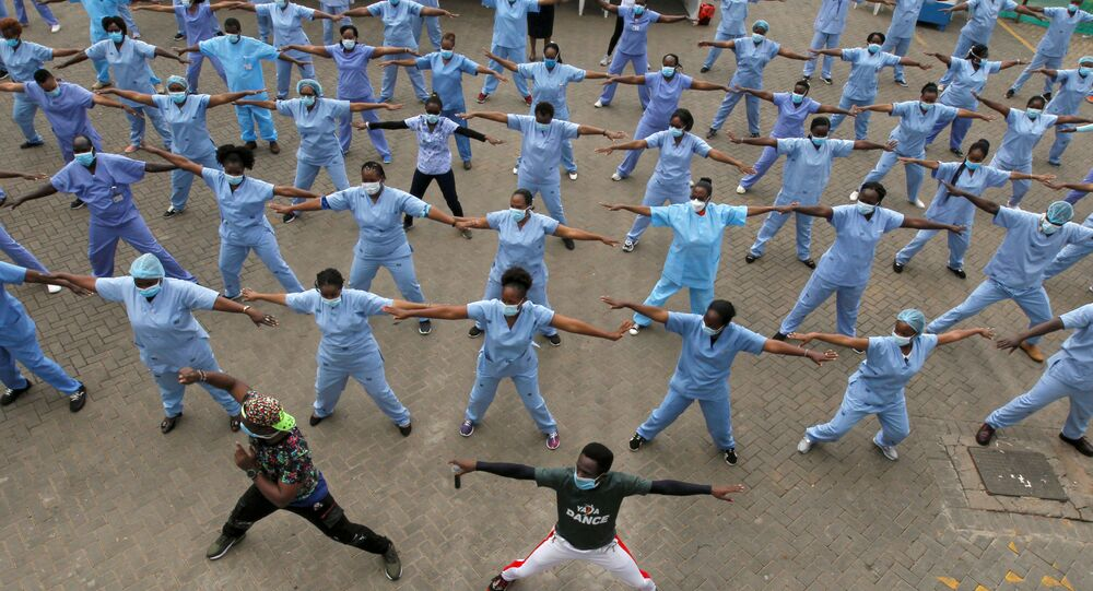 Nurses participate in a Zumba aerobic fitness program as a way of helping them to cope with working situations during the coronavirus disease (COVID-19) outbreak within the Infectious Disease Unit grounds of the Kenyatta National Hospital in Nairobi, Kenya May 28, 2020.