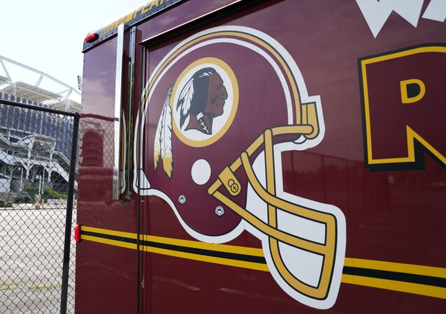 The Washington Redskins team logo is seen on a vehicle parked outside the NFL team's stadium FedEx Field after the team announced it will be abandoning its controversial Redskins team name and logo under pressure from sponsors to scrap the name criticized as racist by Native American rights groups, in Landover, Maryland U.S., July 13, 2020