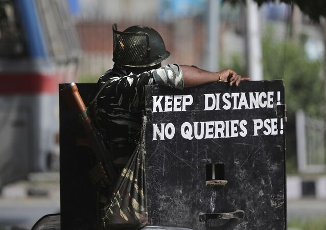 An Indian paramilitary soldier stands guard at a check point during restrictions in Srinagar, Indian controlled Kashmir, Friday, Aug 30, 2019. India on Thursday said it has information that Pakistan is trying to infiltrate terrorists into the country to carry out attacks amid rising tensions over New Delhi's decision to abrogate the autonomy of Indian-administered Kashmir