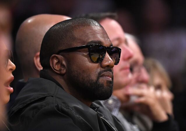 In this Jan. 13, 2020 file photo, Rapper Kanye West watches during the second half of an NBA basketball game between the Los Angeles Lakers and the Cleveland Cavaliers in Los Angeles. Drawings by West from when the rapper was a high school student in Chicago are now worth thousands of dollars, according to an appraiser.