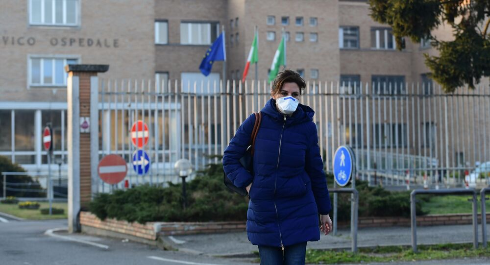 A nurse wearing a protective respiratory mask leaves the municipal hospital in Codogno, southeast of Milan, on February 22, 2020.