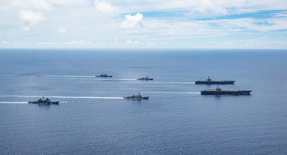 The USS Ronald Reagan (CVN 76) and USS Nimitz (CVN 68) Carrier Strike Groups (CSGs) steam in formation. The Nimitz and Ronald Reagan CSGs are conducting dual-carrier operations as the Nimitz Carrier Strike Force.