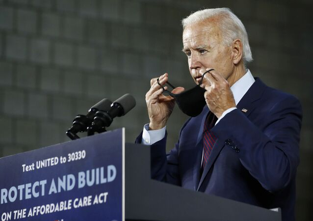 Democratic presidential candidate, former Vice President Joe Biden puts on a face mask after speaking at an event Thursday, June 25, 2020, in Lancaster, Pa