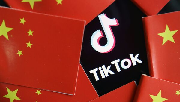 China's flags are seen near a TikTok logo in this illustration picture taken July 16, 2020 - Sputnik International