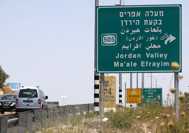 Cars with Palestinian license plates drive through the Tapuach junction, near Nablus, towards the Jordan Valley in the West Bank, on July 1, 2020.