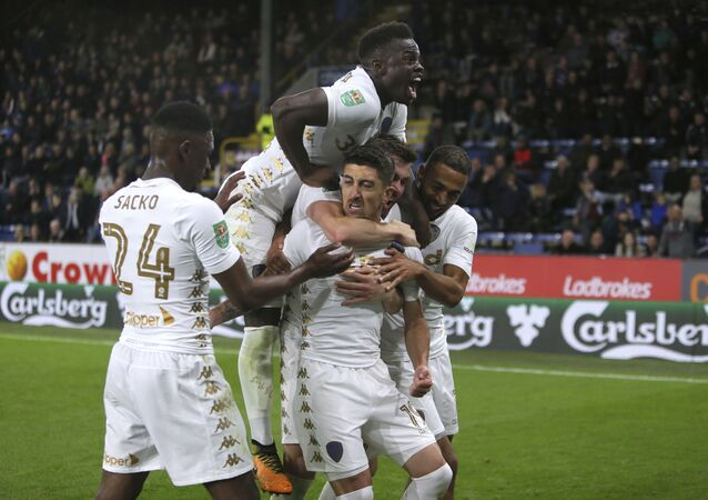 Leeds United's Pablo Hernandez, centre, celebrates scoring his side's second goal of the game during the League Cup third round match Burnley against Leeds United at Turf Moor, Burnley, England, Tuesday Sept. 19, 2017
