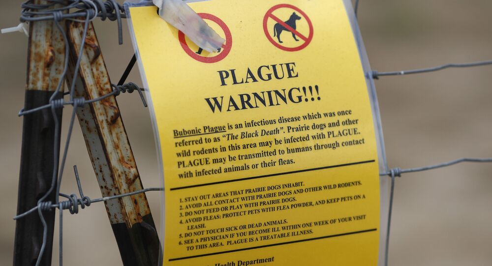A closed sign is displayed at a parking lot near the Rocky Mountain Arsenal Wildlife Refuge, Saturday, Aug. 10, 2019, in Commerce City, Colo. Prairie dogs and other wild rodents in the area may be infested with a plague that can be transmitted to humans.