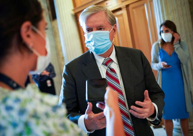U.S. Sen. Lindsey Graham (R-S.C.) speaks with a reporter as he arrives for a vote to close debate on the motion to proceed to consideration of the National Defense Authorization Act in the U.S. Capitol in Washington, U.S., June 25, 2020.