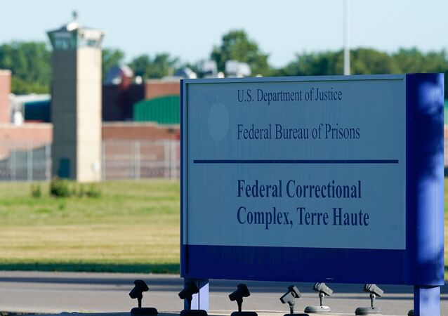 A sign stands outside the Federal Correctional Institution, Terre Haute, as Daniel Lewis Lee, convicted in the killing of three members of an Arkansas family in 1996, is set to be put to death in the first federal execution in 17 years, in Terre Haute, Indiana, U.S. July 13, 2020.