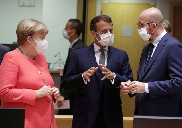 Germany's Chancellor Angela Merkel, French President Emmanuel Macron and European Council President Charles Michel talk at the start of the first face-to-face EU summit since the coronavirus disease (COVID-19) outbreak, in Brussels, Belgium17  July 2020.