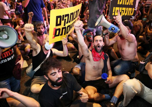 Israelis block a main junction in the city as they protest against the government's response to the financial fallout of the coronavirus disease (COVID- 19) crisis in Tel Aviv, Israel July 11, 2020