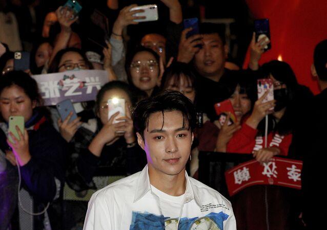 Fans take photos of Chinese singer Zhang Yixing