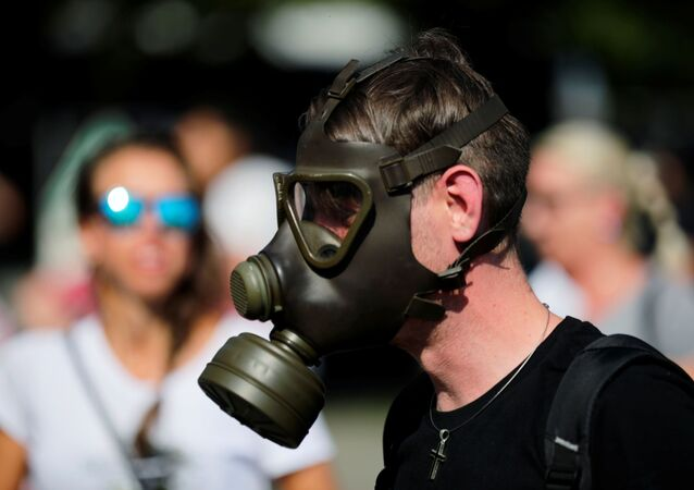 A man wears a gas mask as activists protest against the government's restrictions following the coronavirus disease (COVID-19) outbreak, in Berlin, Germany, July 18, 2020.