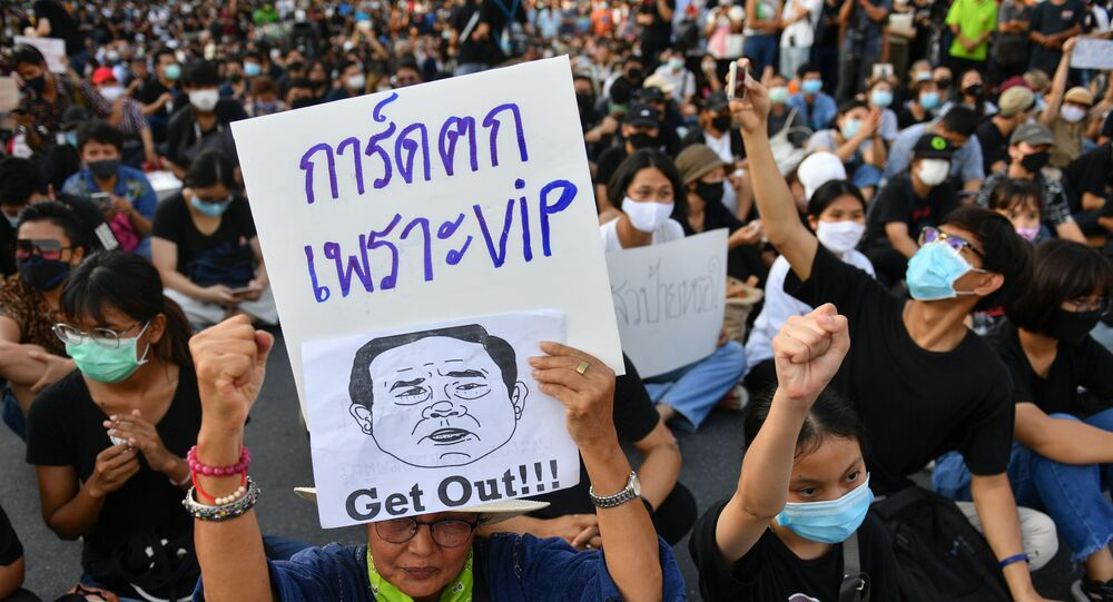 A protester holds a sign depicting Thai Prime Minister Prayuth Chan-Ocha during a protest demanding the resignation of the government, defying the coronavirus disease (COVID-19) restrictions on large gatherings in one of the largest demonstrations since a 2014 army coup in Bangkok, Thailand July 18, 2020.