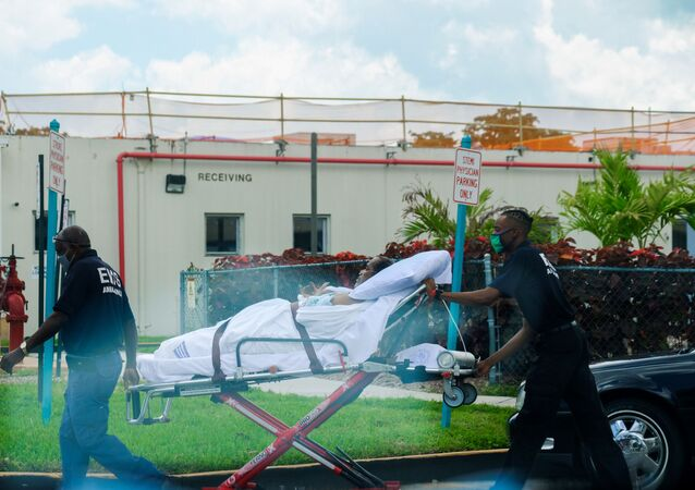 Emergency Medical Technicians (EMT) leave with a patient at North Shore Medical Center where the coronavirus disease (COVID-19) patients are treated, in Miami, Florida, U.S. July 14, 2020.
