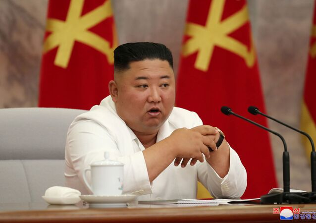 North Korean leader Kim Jong Un guides the 14th enlarged meeting of Political Bureau of 7th Central Committee of WPK in this undated photo released on July 2, 2020