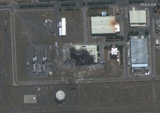 A handout satellite image shows a closeup view of a building damaged by fire at the Natanz nuclear facility in Iran