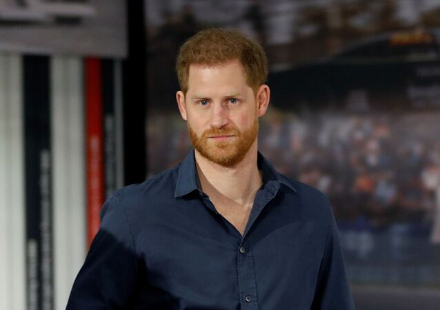 Britain's Prince Harry, Duke of Sussex looks at exhibits during a visit to officially open the Silverstone Experience at Silverstone motor racing circuit, in central England on March 6, 2020