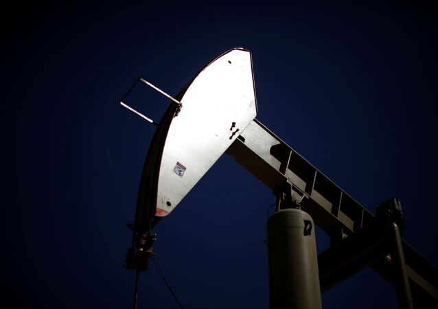 A pumpjack brings oil to the surface  in the Monterey Shale, California, April 29, 2013
