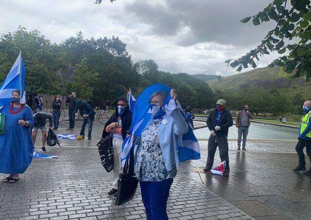 Protest outside of Scottish parliament continues despite heavy rain