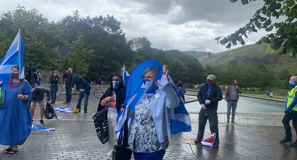 Protest outside of Scottish parliament continues despite heavy rain