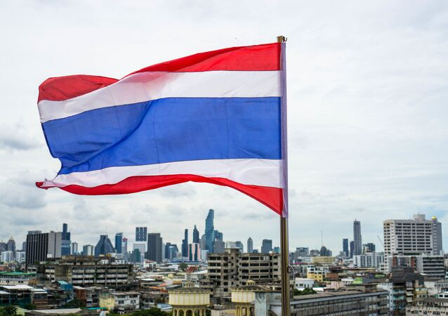 Skyline of Bangkok behind the Flag of Thailand